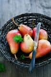 Ripe pears. In a peletny basket Royalty Free Stock Photo