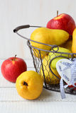 Ripe pears and apples in basket Royalty Free Stock Images