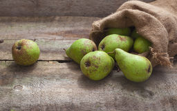Ripe pears in a bag on a wooden background Royalty Free Stock Photos