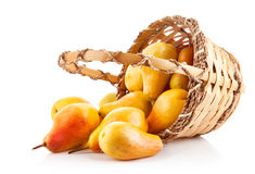 Ripe pears in basket. On white background Royalty Free Stock Images