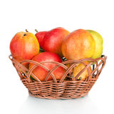 Ripe pears in a basket. On white background Stock Photo