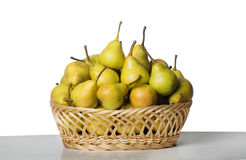 Ripe pears. In a basket Royalty Free Stock Photos
