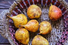 Ripe pears. In basket Stock Photo