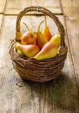 Ripe pears in a basket Royalty Free Stock Photos