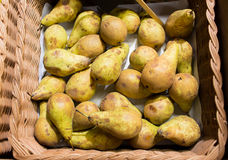 Ripe pears in basket at food market or farm Royalty Free Stock Photo