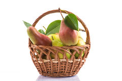 Ripe pears in a basket. On a white background Royalty Free Stock Image
