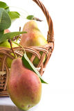 Ripe pears in a basket. On a white background Royalty Free Stock Photos