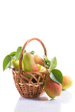 Ripe pears in a basket. On a white background Royalty Free Stock Images