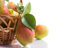 Ripe pears in a basket. On a white background Stock Photography