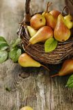 Ripe pears in a basket Stock Photos