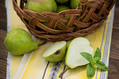 Ripe pears in a basket on  wooden background. Top view. Close-up Stock Images