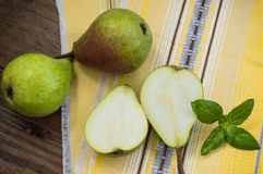 Ripe pears in a basket on  wooden background. Top view. Close-up Royalty Free Stock Images