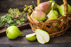 Ripe pears in a basket on  wooden background. Top view. Close-up Stock Photography