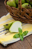 Ripe pears in a basket on  wooden background. Top view. Close-up Royalty Free Stock Photos