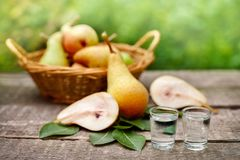 Ripe pears and fruit brandy alcohol drink. Ripe pears and pear fruit brandy alcohol drink in shot glass Royalty Free Stock Image