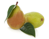 Ripe pears with green leaves isolated on white background. Stock Photos