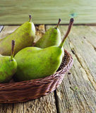 Ripe pears. Large ripe pears in a basket on table Royalty Free Stock Photo
