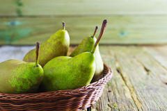 Ripe pears. Large ripe pears in a basket on the table Royalty Free Stock Image