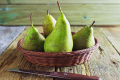Ripe pears. Large ripe pears in a basket on the table Stock Images