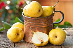 Ripe Pears with leaves on wooden table Stock Photography