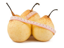 Ripe pears and measure tape Stock Image
