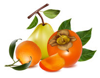 Ripe pears, persimmon and tangerine fruits. Stock Photo