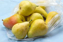 Ripe pears in a plastic bag Royalty Free Stock Photo