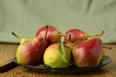 Ripe pears on a plate Stock Photography