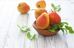 Ripe pears in wood bowl stock image