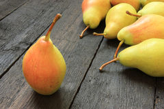 Ripe pears on wooden background Royalty Free Stock Images