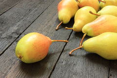 Ripe pears on wooden background Royalty Free Stock Image