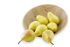 Ripe pears in a wooden bowl, isolated on white. Background Stock Photography