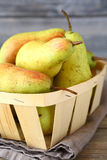 Ripe pears in a wooden box Stock Photo