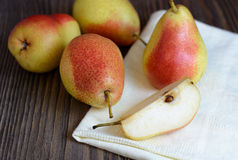 Ripe pears in a wooden table Stock Photo