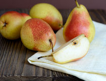 Ripe pears in a wooden table Stock Image