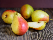 Ripe pears in a wooden table Stock Photos