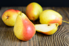 Ripe pears in a wooden table Royalty Free Stock Images
