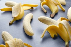 Ripe peeled bananas. On table Royalty Free Stock Image
