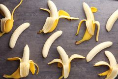 Ripe peeled bananas. On table Stock Images