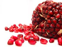 Ripe peeled pomegranate fruit and seeds on white Royalty Free Stock Photos