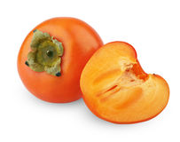 Ripe persimmon with cut Royalty Free Stock Image