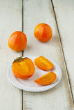 Ripe persimmon with cut Royalty Free Stock Photography