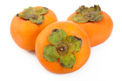 Ripe persimmon fruit isolated on white Royalty Free Stock Photo