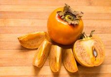 A ripe persimmon Royalty Free Stock Photos