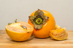 A ripe persimmon Royalty Free Stock Photo