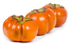 Ripe persimmons Stock Photos