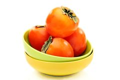 Ripe persimmons in a bowl. Royalty Free Stock Image