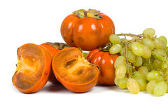Ripe persimmons and grapes Royalty Free Stock Photos