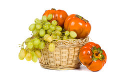 Ripe persimmons and grapes Royalty Free Stock Images