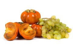Ripe persimmons and grapes Stock Photography